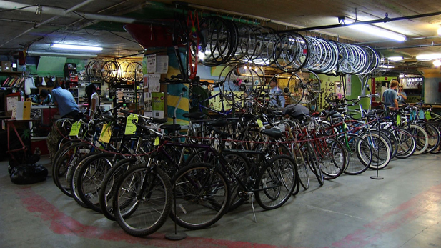 Inside Bicas, a local bike shop that not only fixes and builds bikes for customers, but shows them the ins and outs of bicycle maintenance.