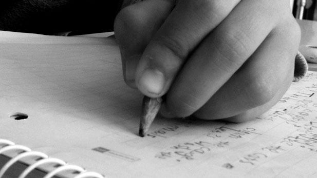 writing hand spotlight