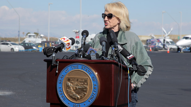 Ariz. Gov. Jan Brewer speaking to reporters in Tucson after a February 2013 tour of the border.