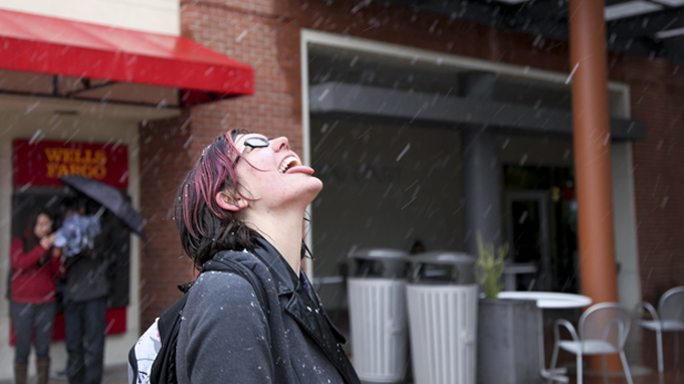 Kiera Woods catches snowflakes on her tongue outside the student union on Wednesday, Feb. 20, 2013.