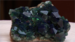 A close up of a freshly excavated piece of fluorite.