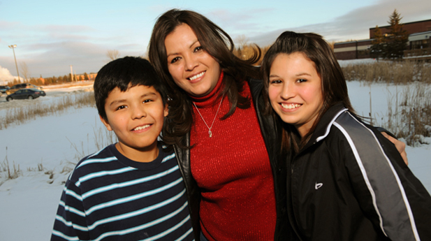 Robin Charboneau (center) and her children, Anthony (left) and Darian (right).