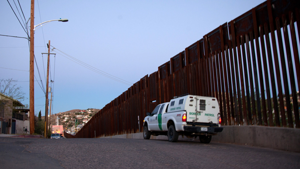 A U.S. Border Patrol vehicle on the American side of the border fence in Nogales, Ariz.