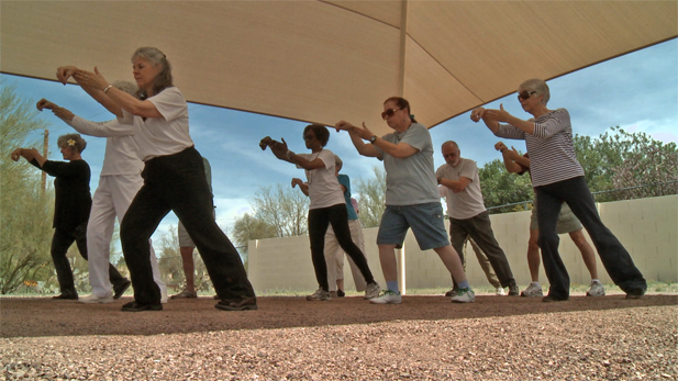 A tai chi class gathers to practice in north Tucson. A new UA study finds tai chi can help prevent falls in stroke survivors.