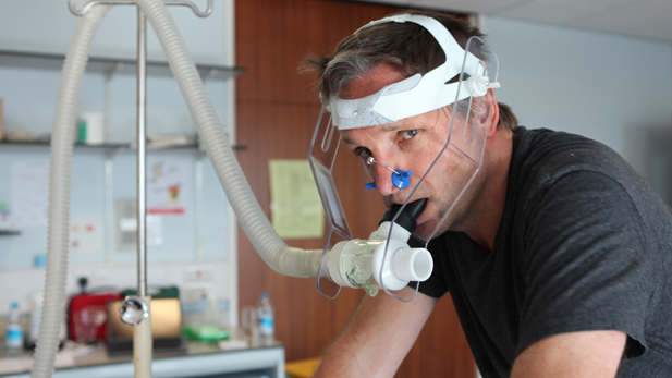 DR MICHAEL MOSLEY at University of Nottingham Medical School enduring a tough cycling test that will measure his VO2 max (the maximum capacity of an individual's body to transport and use oxygen).