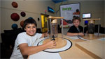 Two children enjoying their time with the summer programs offered at the Children's Museum.