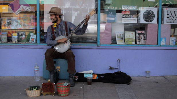 Mikee Pruitt busks in the streets of Tucson.
