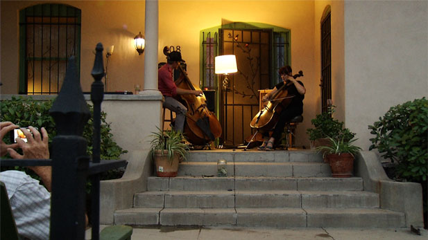 Front porches all over the Armory Park Historic District come alive with live music.