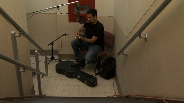 Singer / songwriter / musician Joe Peña performs in the AZPM stairwell