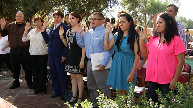 Thirteen new U.S. citizens take their oath of allegiance in a ceremony at Tumacacori National Historic Park on Sept. 17, 2013.