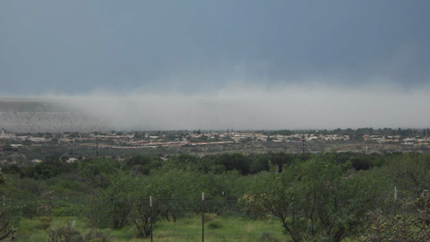 Dust blows from Freeport MacMoRan mine tailings near Green Valley, Ariz., in July 2013. The incident led Pima County to issue a notice that the company violated air quality standards.