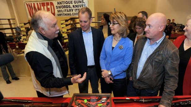 Former Congresswoman Gabrielle Giffords and her husband, Mark Kelly, right, with Saratoga Springs, N.Y., gun show organizer Dave Petronis, left, and New York Attorney General A.G. Schneiderman, second from left,Oct. 13, 2013.