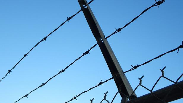 Barbed wire, prison, jail stock spotlight