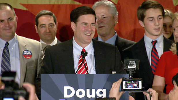 Republican Doug Ducey celebrating Arizona governor's race win at a gathering in Phoenix.