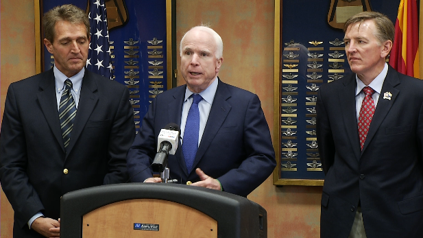 Sens. Jeff Flake (left) and John McCain (center) and Rep. Paul Gosar, at Davis-Monthan Air Force Base Dec. 18, 2014.