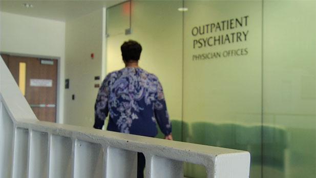 Woman walking towards Outpatient Psychiatry office.