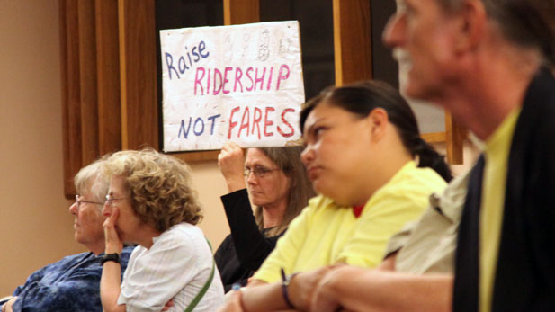 Members of the Tucson Bus Riders Union protest proposed bus fare increases outside the Tucson City Co