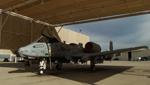 An A-10 plane sits in a hanger at Davis Monthan Air Force Base.