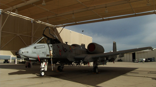An A-10 plane sits in a hanger at Davis Monthan Air Force Base.