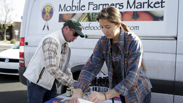 Dan Cornelius, left, and his assistant set up the Mobile Farmers Market at Tucson's Native Seeds/SEARCH.