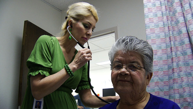 Linda Williams, a physician at El Rio Community Health Clinic, performs a routine checkup on her patient.