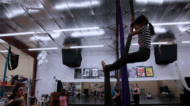 Young girl practicing aerial silk.