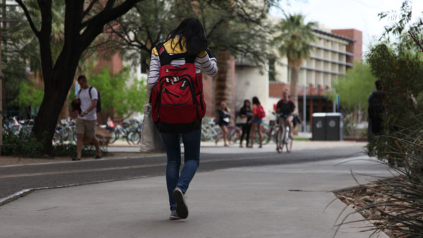 Student walking at the University of Arizona.