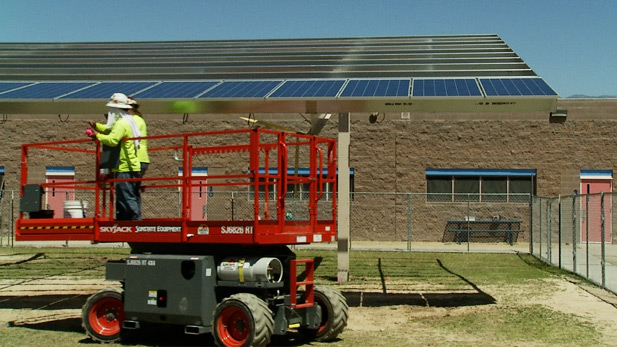 Crew installing solar panels at Tucson's Soleng Tom Elementary School in April 2014.