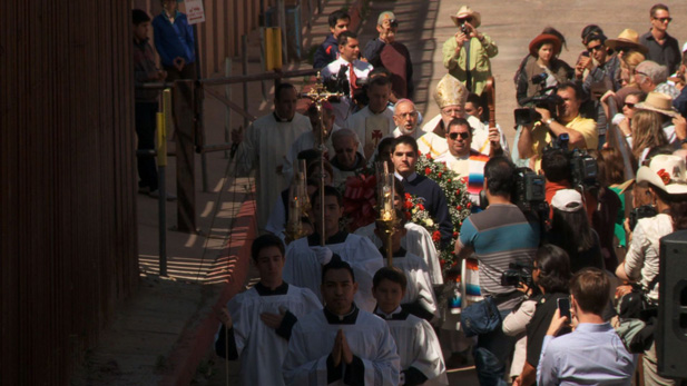 A catholic procession takes place right along the U.S. Mexico Border.