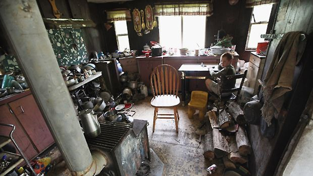 Johnny Noble, 9, sits in his uncle's trailer during a visit on April 21, 2012 in Owsley County, Kentucky. Photo by Mario Tama/Getty Images