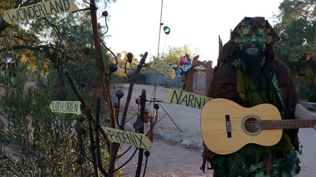 Zack Jarrett - dressed as The Green Man - leads a singalong at Valley of the Moon