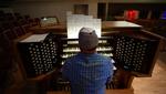 Dennis Grannan, Principal Organist for Catalina United Methodist Church, plays the new organ at the church.