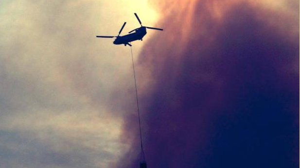 Firefighting helicopter above the Slide Fire in northern Arizona's Oak Creek Canyon.
