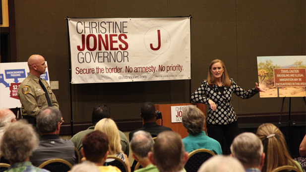 GOP gubernatorial candidate Christine Jones joined by Pinal County Sheriff Paul Babeu at a Tucson town hall meeting on immigration the evening of Thursday, July 11, 2014.
