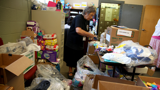 Volunteers sorting through donations at Catholic Community Services drop off site.