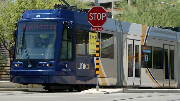 Tucson's streetcar emerges from the Fourth Avenue underpass.