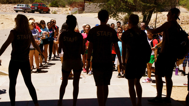 Triangle Y campers line up in front of counselors before lunch.