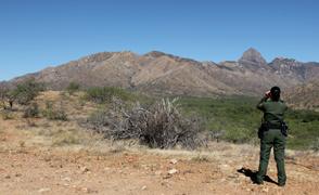 Border Patrol agent in desert generic focus large