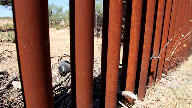 A water jug used by border-crossers left behind on the Mexican side of the international border fence.