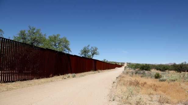 The international border fence in the Arizona desert.