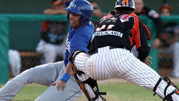 Action at the 2014 Tucson Mexican Baseball Festival.