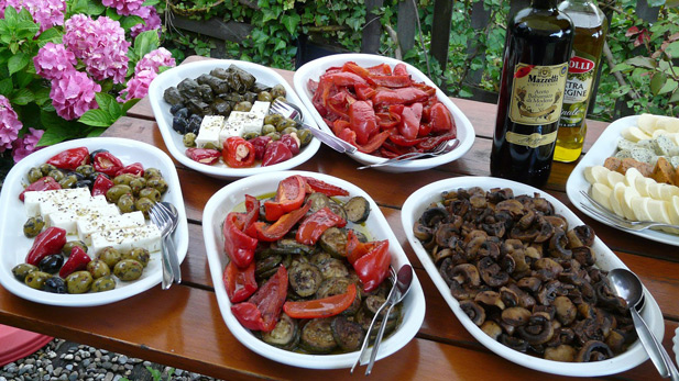 A Mediterranean diet consists mostly of fruits, vegetables, whole grains, beans, nuts, fish, olive oil and red wine.
