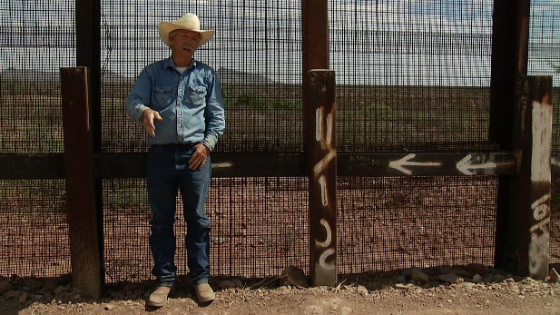 Cochise County rancher John Ladd explains how people cut the fence to cross where his ranch abuts the border.