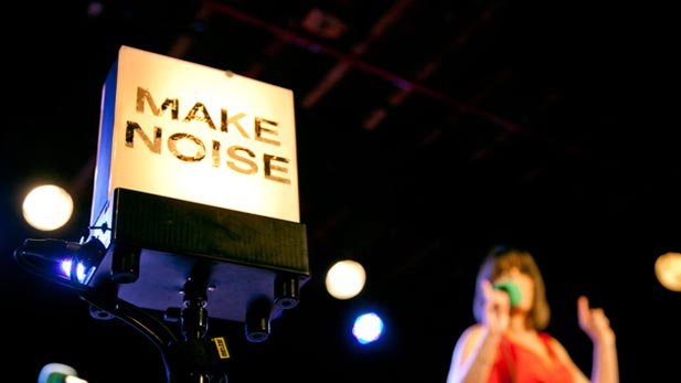 "The ""Make Noise"" sign onstage at The Bell House, Brooklyn, NY