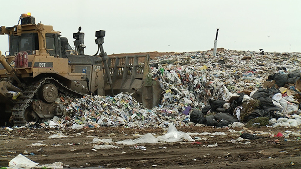 A bulldozer moves trash at Tucson's Los Reales Landfill.