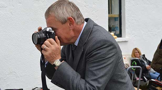 Martin Clunes taking photos on set