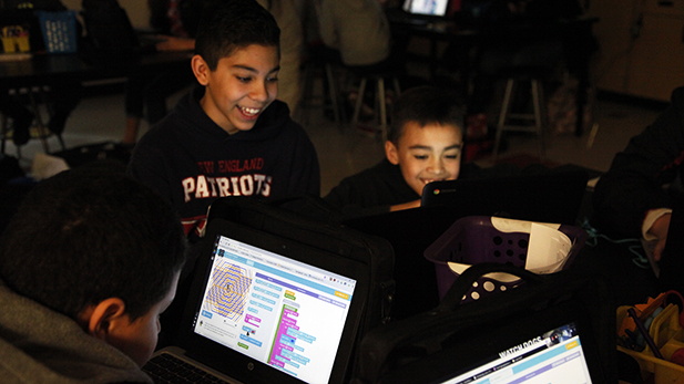 Sixth graders Jonathan Rodriguez and Anthony Diaz work on creating art with code at Gallego Intermediate on Friday, Dec. 11, 2015.