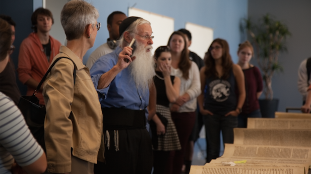 Rabbi Gedaliah Druin explains to students and faculty his techniques for repairing an ancient Torah.