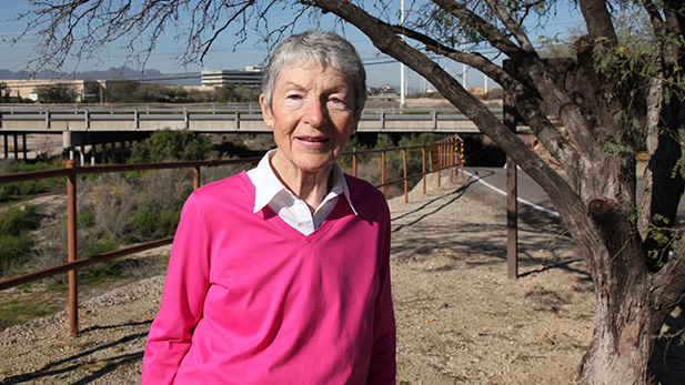 Elizabeth Gunn stands along the Rillito Riverbed and multi-use path. This is the opening scene in the first book in her Tucson mystery series.
