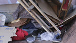 Clothing, wood scraps and blankets are pictured in a City of Tucson dumpster on Friday, March 13, 2015. The trash was from the deconstruction of the Safe Park protest in downtown Tucson.